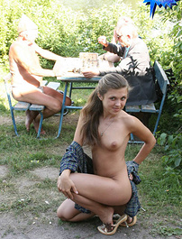 Busty flasher poses nude in front of 3 old farts
