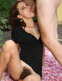 Slutty lady Leslie gives her stud a sinful blowjob and later rides his cock with her natural hairy pussy