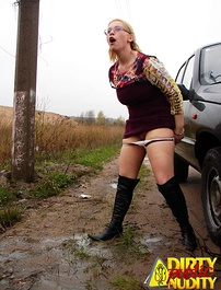 Luba pissing on the road