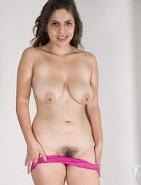 A black dress covers up Anastasia Cherry, but she undresses to show off her purple panties and hairy pussy. She climbs on the table naked, and stretches open her wet pink pussy, and is beautiful today.