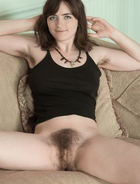 Snow is sexy in her black dress and shows off her hairy pits on her couch. She strips naked, and has a very hairy bush. She is completely all natural everywhere, and is a beautiful hairy model right?